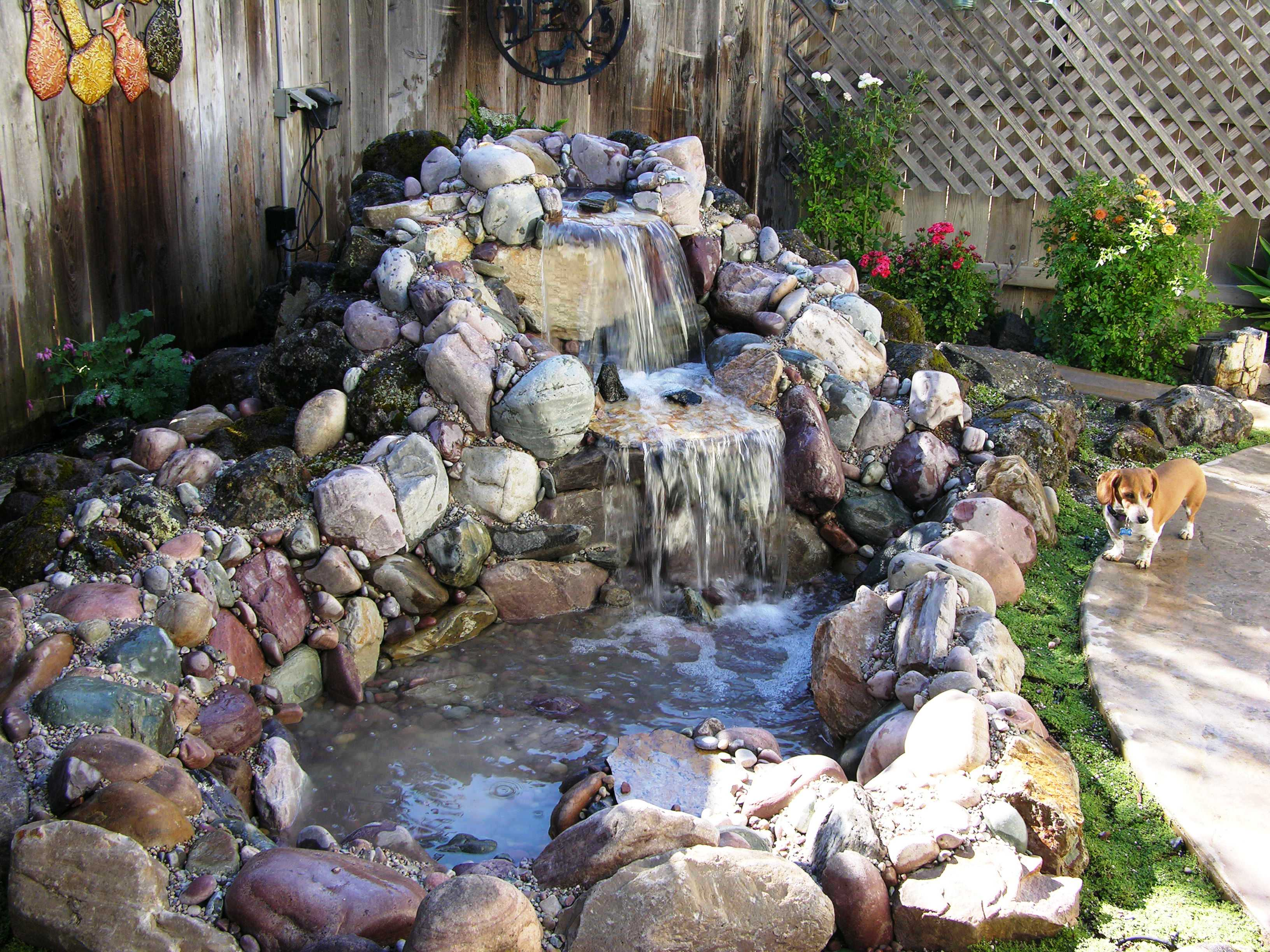 Larry bender 39 s landscaping about us Backyard pond ideas with waterfall